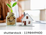 saving money to invest in house ... | Shutterstock . vector #1198449400
