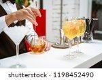 bartender making cocktails at...   Shutterstock . vector #1198452490