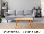 wooden table on carpet in front ... | Shutterstock . vector #1198454350