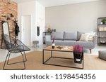 modern armchair next to wooden...   Shutterstock . vector #1198454356