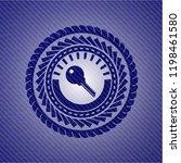 key icon inside denim background   Shutterstock .eps vector #1198461580