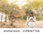 young traveler teen woman using ... | Shutterstock . vector #1198467766