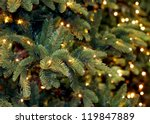 Stock photo christmas lights hanging in a tree 119847889