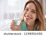 young woman with glass of clean ... | Shutterstock . vector #1198501450