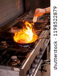 chef cooking with high fire in...   Shutterstock . vector #1198522879