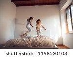 two sisters  wearing white... | Shutterstock . vector #1198530103