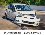 crashed car after accident with ... | Shutterstock . vector #1198559416