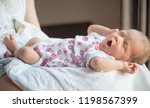 baby is yawning. infant with... | Shutterstock . vector #1198567399