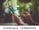 women hand using smartphone... | Shutterstock . vector #1198604539