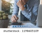 businessman working on... | Shutterstock . vector #1198605109