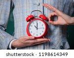 alarm clock in hands of teacher ...   Shutterstock . vector #1198614349
