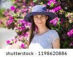 young girl in a hat on a...   Shutterstock . vector #1198620886