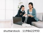 Small photo of shrewd housewife checking the payment amount of the insurance scheme plan by calculator with the sales. Agent woman presentation and consulting insurance detail to customer.