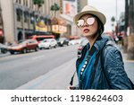elegant female traveler... | Shutterstock . vector #1198624603