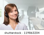 Portrait of a friendly call center operator, office background - stock photo
