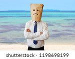 sad businessman on the beach | Shutterstock . vector #1198698199
