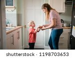 little boy and his mother... | Shutterstock . vector #1198703653