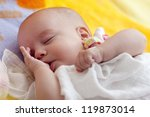 Adorable Baby Girl is sleeping in the bed - stock photo