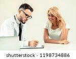 male doctor talks to female...   Shutterstock . vector #1198734886