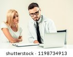 male doctor talks to female...   Shutterstock . vector #1198734913