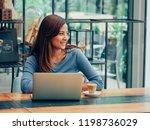 asian woman drinking coffee in  ... | Shutterstock . vector #1198736029