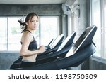 fitness asian woman with... | Shutterstock . vector #1198750309