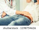 male having stomachache. woman...   Shutterstock . vector #1198754626