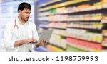 pharmacist or doctor using... | Shutterstock . vector #1198759993