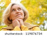 Nice Older Woman Stands On A...