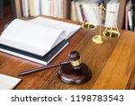 wooden judges gavel on wooden... | Shutterstock . vector #1198783543