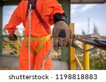 worker in safety harness on... | Shutterstock . vector #1198818883