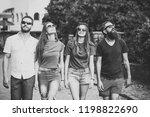 group of friends walking on... | Shutterstock . vector #1198822690