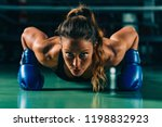 woman on boxing training doing... | Shutterstock . vector #1198832923