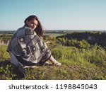 young woman posing in a field... | Shutterstock . vector #1198845043