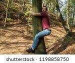 Man Love Nature Hug Tree...