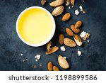 almond oil in bowl and almond... | Shutterstock . vector #1198899586