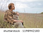 young shaggy and unshaven guy... | Shutterstock . vector #1198942183