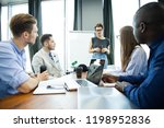 discussing new business ideas.... | Shutterstock . vector #1198952836