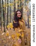 pretty young woman walking in... | Shutterstock . vector #1198955680