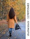 pretty young woman walking in... | Shutterstock . vector #1198955683