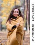 pretty young woman walking in... | Shutterstock . vector #1198955686
