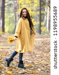 pretty young woman walking in... | Shutterstock . vector #1198955689