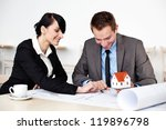 Two architects working sitting around table. - stock photo