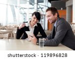 Business couple meeting with digital tablet - stock photo