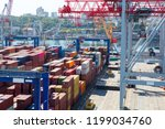 industrial port with containers | Shutterstock . vector #1199034760