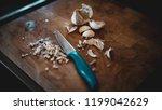 chopped garlic on a wooden... | Shutterstock . vector #1199042629