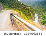dirty road and futaleufu river  ... | Shutterstock . vector #1199043856