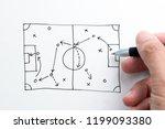 hand holding pen sketching... | Shutterstock . vector #1199093380