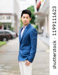 young businessman asian smiling ... | Shutterstock . vector #1199111623