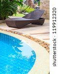 chaise lounges in swimming pool | Shutterstock . vector #119912320